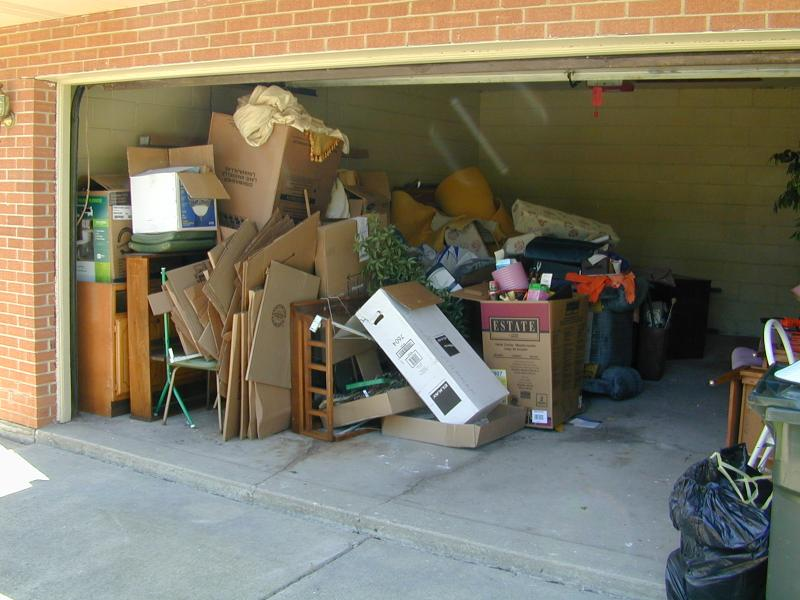 How can a junk removal service help when cleaning out your garage?